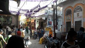crowd roams indian street with Diwali decorations